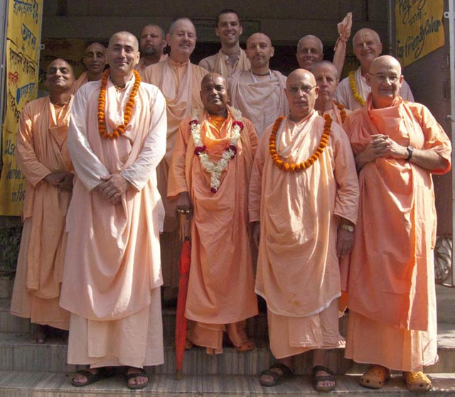 Left to right: Sripad Bhakti Niskama Shanta Maharaj, Sripad Bhakti Prapanna Tirtha Maharaj, Sripad Bhakti Vijay Trivikram Maharaj, Sripad Bhakti Bimal Avadhut Maharaj, Sripad Bhakti Vigraha Nyasi Maharaj, Srila Bhakti Nirmal Acharya Maharaj, Sripad Bhakti Kamal Tyagi Maharaj, Sripad Bhakti Chaitanya Bharati Maharaj, Sripad Bhakti Pavan Janardan Maharaj, Sripad Bhakti Sampat Narayan Maharaj, Sripad Bhakti Sudhir Goswami Maharaj, Sripad Bhakti Kusum Ashram Maharaj, and Sripad Bhakti Chandan Parvat Maharaj.