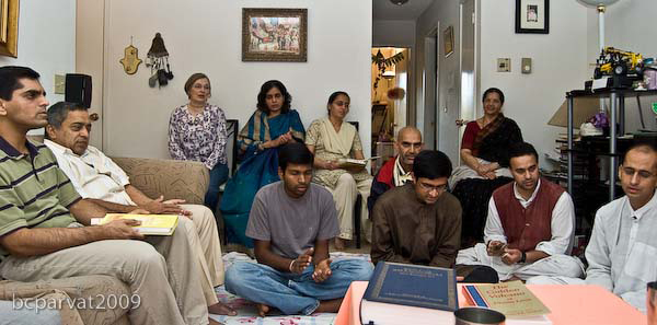 Devotees and friends gathered in the home of Jairam Prabhu